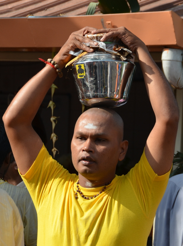 Carrying a pot with milk