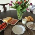 Dutch delicacies: raw herring, strawberries, Dutch cheese and buttermilk