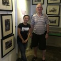 With the manager of the gallery